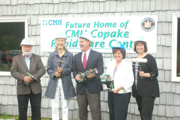 Tools at the ready, (l-r), Copake Town Supervisor Jeff Nayer, Copake Hamlet Revitalization Taskforce Chair Roberta Roll, Columbia Memorial Health CEO/President Jay Cahalan, State Senator Kathleen Marchione (R-43rd) and CMH Board of Trustees Chair Mary Gail Biebel ceremonially break ground for the new Rapid Care Center coming to Copake. Photo by Christopher Quinby